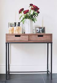 Small entrance table Apartment Decorated Entryway Table Adds Warm Inviting Accent Pinterest Decorated Entryway Table Adds Warm Inviting Accent Home