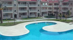 a view of the pool at 16 jasmine apartment botanik gardens or nearby
