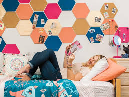 Dress up your walls with a variety of different shapes for easily storing books, jewelry, makeup, or small trinkets. 20 Removable Dorm Room Decor Ideas Hgtv Crafternoon Hgtv