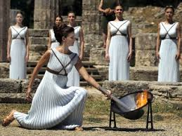 flame lighting olympics. the olympics torch was lit at site of ancient games. reuters flame lighting l