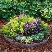 Round raised herb garden bed @ Juxtapost.com