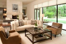 living room a warm and cozy living room ideas in a wide cream room with the same color couch and furnitures beautiful arcylic table plant and standing