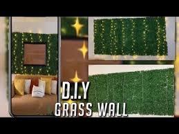 diy grass wall w hanging lights under