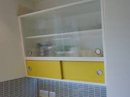 1950 s style angled wall cabinet with formica and reeded glass doors custom made