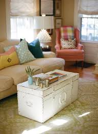 old worn white shabby chic trunk coffee table in living room
