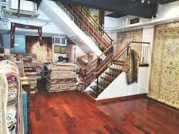 owner shah luqman whose family emigrated to hong kong from stan in the 1950s imports the bulk of his rugs from iran and afghanistan