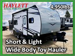 1 travel trailer 3 toy hauler age new bath front bed queen bed true queen bedroom rear bunks rear bunks happi jac body wide construction standard