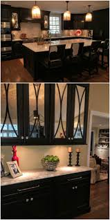 backsplash lighting. dark painted kitchen mercury glass fronted doors with arched mullions light countertops under backsplash lighting