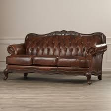 classic brown tufted acton leather chesterfield sofa with combined carved art wooden frames using kaylyn t captivating living room design tufted