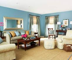 pastel blue walls and a matching accent rug complemented by wicker elements blue