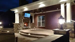 raised concrete patio. Outdoor Living Area With Stone Fireplace Raised Concrete Patio