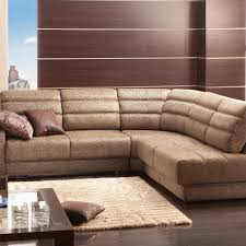 furniture brown upholstered sectional sofa with brown cushion seat plus cream fur rug on wooden