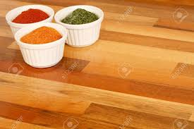Kitchen Worktop Bowls Of Spice On A Wooden Kitchen Worktop Stock Photo Picture