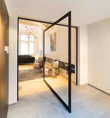 this glass pivot door has a unique central pivoting hinge that allows it to swing in
