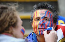 sports fan face paint. barca fans getting ready sports fan face paint o