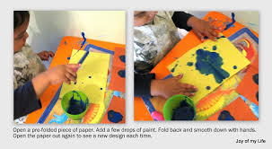 kids art folded paper paint blobs