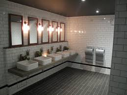 cool toilet design with stylish subway tiles from solus ceramics commercial bathroom