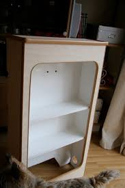 the almost finished wardrobe unit with added shelves edge trim now