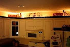 lighting above cabinets. Lighting Above Cabinets...using 24 Foot Rope Light ($15.00) Cabinets H
