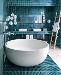 please search for balance and elegant measure when decorating your bathroom covering the floor walls and even ceiling with graphically expressive tiles
