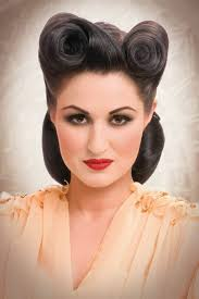 dark haired woman with hair styled up in victory rolls dark eye make up 140 rockabilly hair ideas inspired from the 50 s