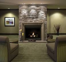 contemporary family room decor with grey fabric sofa set also ceiling lighting decors over stone fireplace ideas
