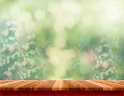 Empty Wood Plank Table With Blur Christmas Tree Green Background