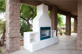 white prefab outdoor fireplace
