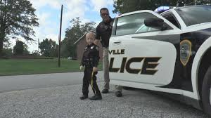 6 year old boy becomes police officer
