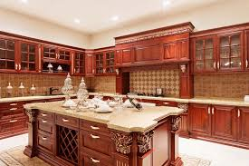 luxury kitchen cabinets. Red-toned Wood Kitchen Cabinets That Are Intricate In Design And Include Many Glass-faced Up Top. Luxury