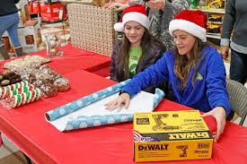 gift wrapping fundraiser gives back to local youth clubs