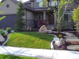 window landscaping unique stone and nice staircase closed wood door side small window front yard landscaping