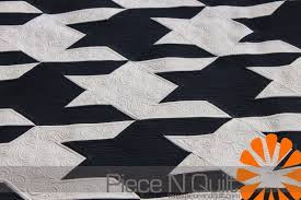 Piece N Quilt: Houndstooth Quilt - Custom Machine Quilting & Next, I machine quilted swirls in all of the white blocks and straight  lines in all of the navy blue blocks. I love how it turned out, modern and  clean! Adamdwight.com