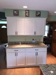 after beautiful newly refaced cabinets in a modern easy to clean and maintain white finish
