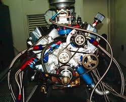 reference nascar model cars magazine forum similar dry sump setup but not entirely plumbed as it would be in the car there s what appears to be a scavenge manifold kinda dangling from 3 lines