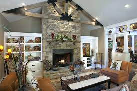 stone fireplace with built ins country living room with hardwood floors stone fireplace exposed beam built stone fireplace with built ins