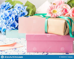 Floral Design Gift Boxes Blank Pink Card And Stacked Gift Boxes Flowers Stock Image