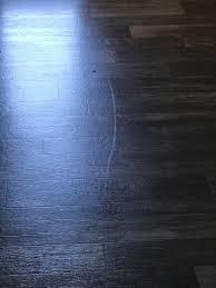 a white mark on a vinyl floor