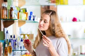 young w buying perfume in a shop or store testing the stock photo young w buying perfume in a shop or store testing the fragrance a paper tester