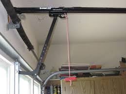 torsion spring garage door opener. garage door red pull handle with j arm and springs torsion spring opener