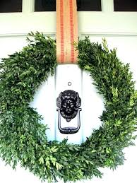 magnetic wreath hanger for double pane glass storm door