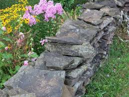 stacked rock walls work well to contain overflow and reduce maintenance gardenerspath com