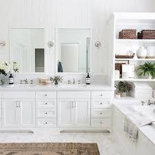 built in shelving unit over bathtub