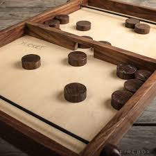Wooden Puck Game Pucket Based on the traditional French game 'Table a L 1