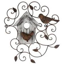 add a dainty shabby chic touch to your home with this metal wood swirl wall decor with birds house this pretty piece features antique rust colored angled metal legs 4quotw