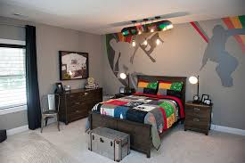 view in gallery custom mural on the wall and sports bedding from pottery barn for the boys bedroom