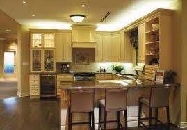 home lighting tips. the recessed lighting over cabinets brightens room without harsh glare home tips h