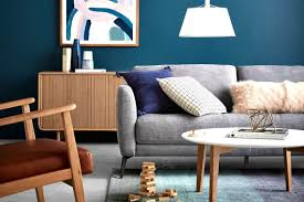 freedom furniture living room with grey sofa and deep blue feature wall with abstract artwork