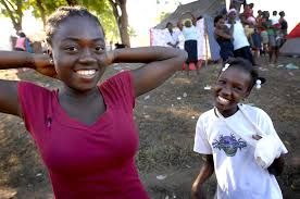 u s department of defense photo essay two girls smile for the camera at a survivor camp in port au prince