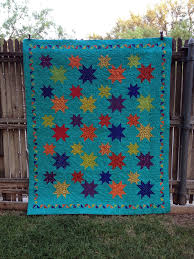 LONGARM QUILTING #12 - 2014 | The Quilting Queen Online & Kathy made this quilt. Stars are one of my favorites. Don't you just love  the tiny half square triangle border around it. Adamdwight.com